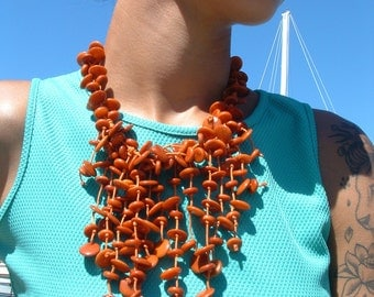 Oceanica Tagua nut waterfall necklace roasted orange by Allie