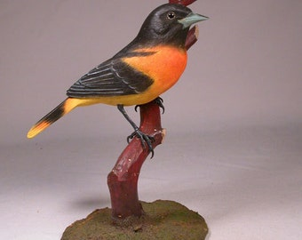 Baltimore Oriole on branch Wooden carved Bird