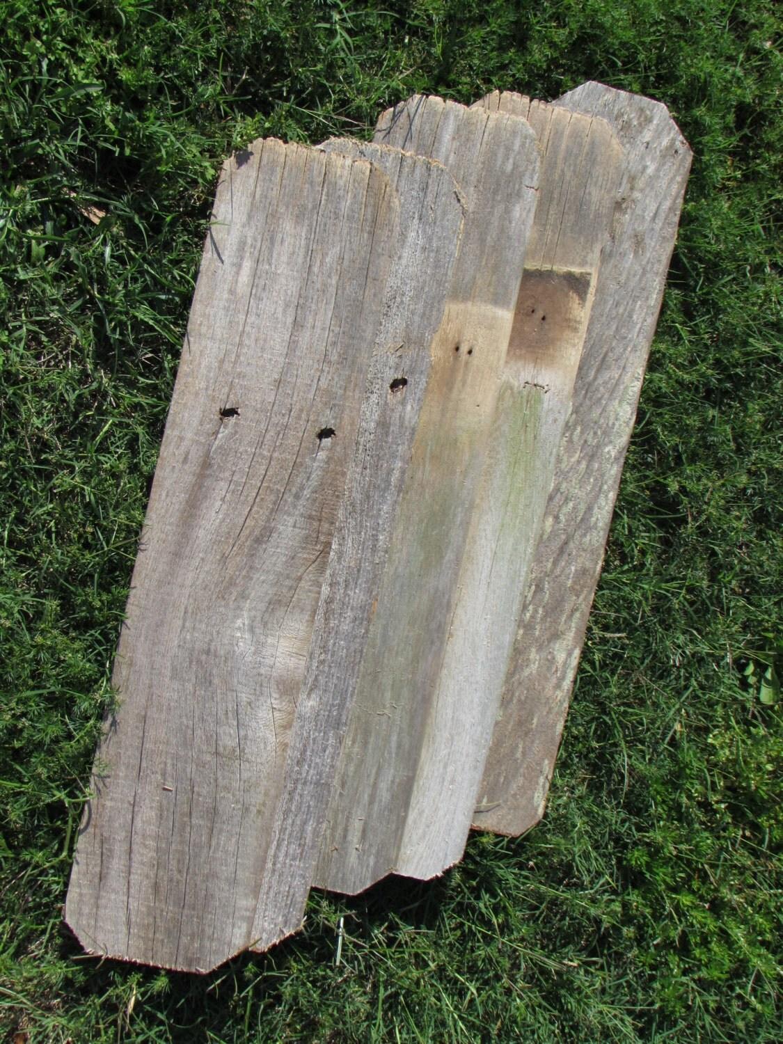 Reclaimed planks old fence wood boards with dog ears at both