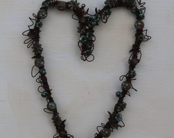 handmade beaded barbed wire heart with metallic turquoise color and gold painted beads