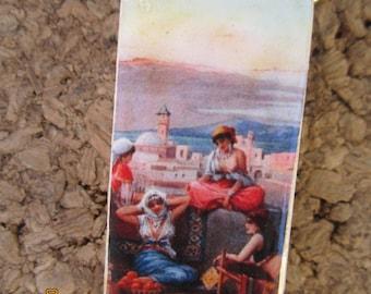 Vintage Haram ladies on roof top domino pendant. Sale, half price
