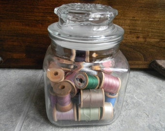 Vintage glass compote storage jar with wooden thread spools farmhouse retro chic craft supplies