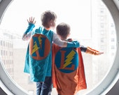 PERSONALIZED Superhero Cape TURQUOISE and ORANGE with bolt - Choose the Initial and Colors