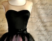 Black leotard with sweetheart neckline and sheer shoulders. Some sizes ready to ship