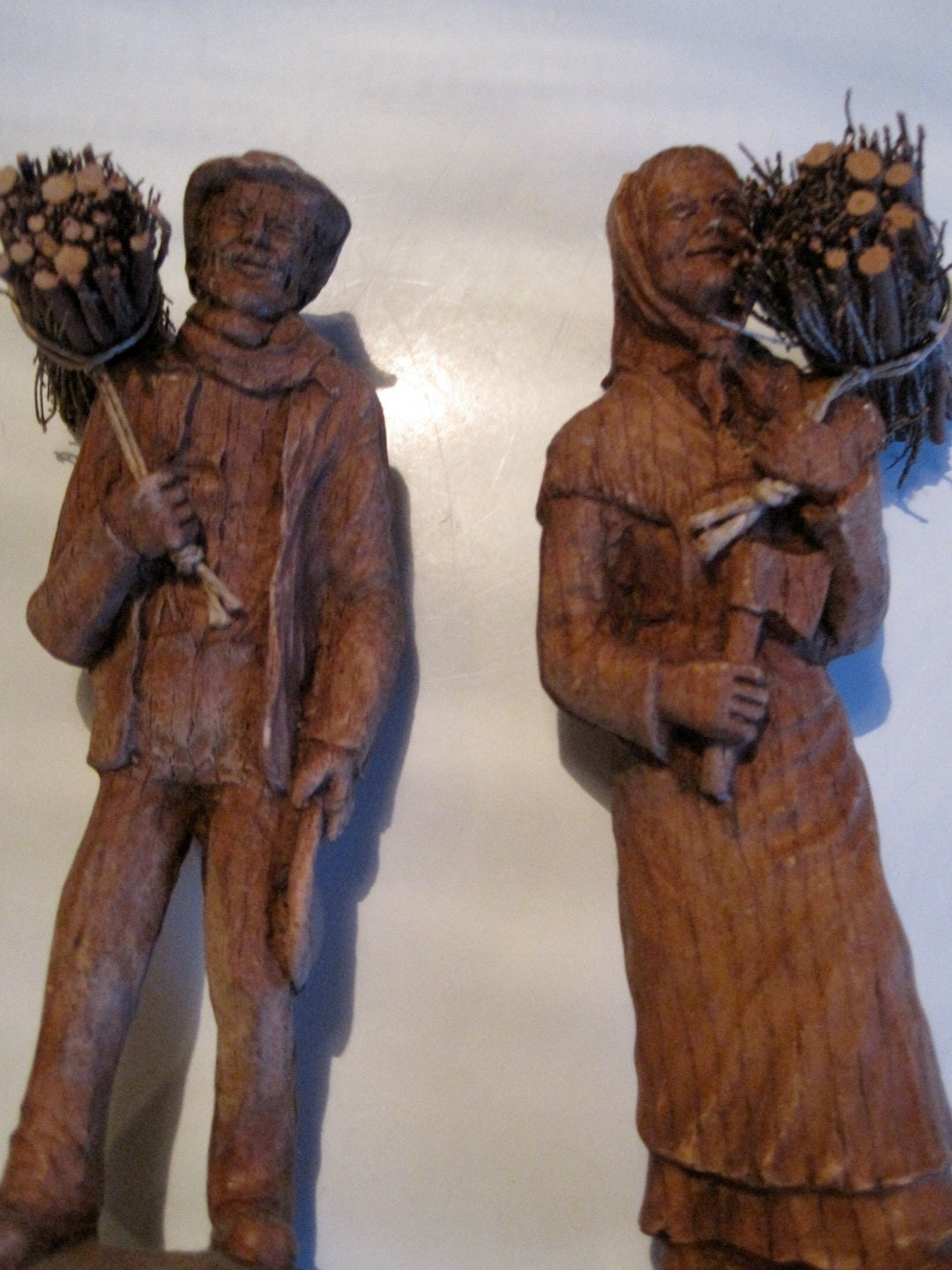 German wood carvings of man and woman s bought in germany
