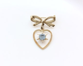 dangling pin bow with gold heart light blue rhinestone vintage bow and heart pin