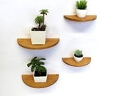 Set of four half round cherry wood floating shelves
