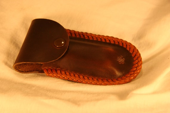 brown leather laced harmonica with belt by