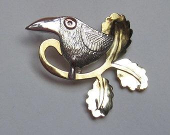 bird brooch with oak leaves