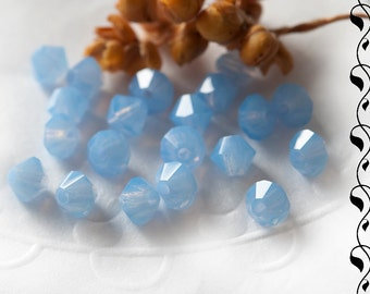 M.C. beads Bicones 4 mm Sky Blue Opal 30 pcs.