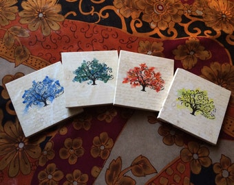 Set of four handpainted stone four seasons coasters. Magical mysterious home decor, great gift!