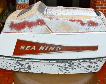 Vintage Sea-King Outboard motor cover. Displays great. Lake cottage or cabin. Found object art.