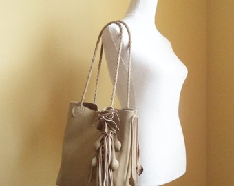taupe leather handbag tote with leaf fringe and flower by Tuscada. Made to order