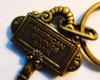 This is an American savings bank keychain in excellent condition no scratches or dings or anything apparent on the item. It has a nice bronz