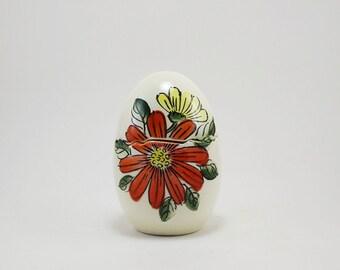 Vintage Lego cracked egg salt & pepper shaker set with orange and yellow flowers, Leo Goldman Imports