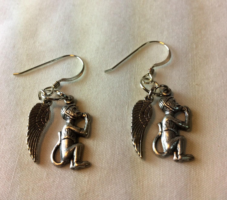 oz flying monkey earrings by beadazzledbysharon on etsy