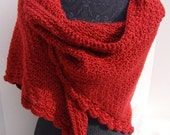 Cranberry red hand-crocheted shawl with moss stitching and scallop edging