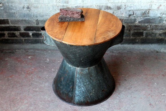 repurposed vintage balinese cooking pot table dark metal and