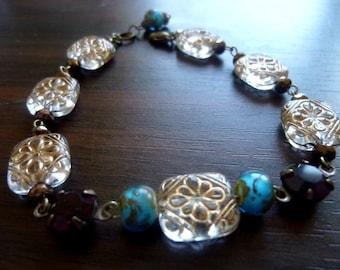 EMIT REMMUS - Gold Etched Floral Tabs Deep Garnet Glass Rounds Bracelet