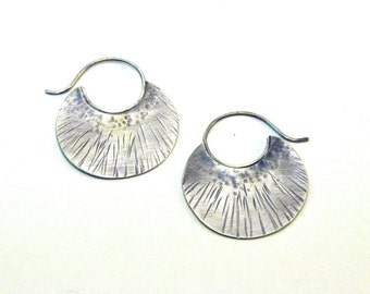 Tribal style silver disc hoops