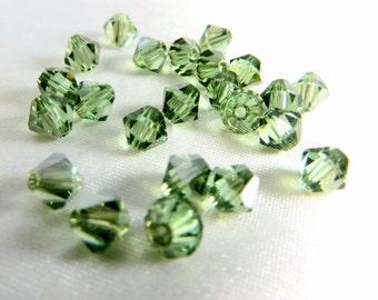 25 Swarovski Light Green Chrysolite Satin 5mm Bicone Jewelry beads