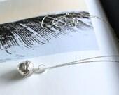Ekollon: Sterling silver chiming acorn necklace