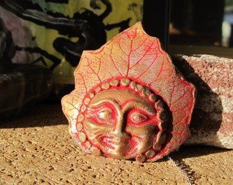 Barrette Leaf Impression with Happy Buddah Face in Gold and Patina on Red