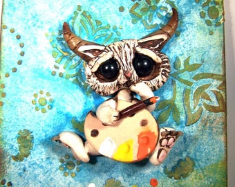 Artist Kitty Kathy with Horns mixed media on 5x7 canvas original polymerclay sculpture attached A Covington Creation.