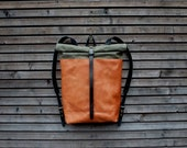 Leather backpack with waxed canvas  roll to close top and vegetable tanned leather shoulderstrap and back reinforcement