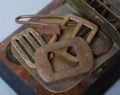SALE... Set of 5 Antique different belt buckles. primitive finding.