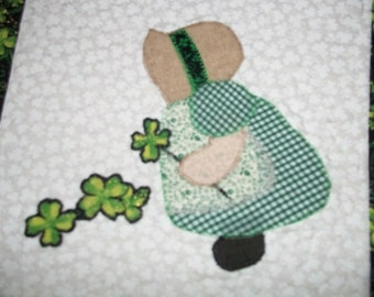 Quilted St Patrick's Day Sun Bonnet Sue picking shamrocks