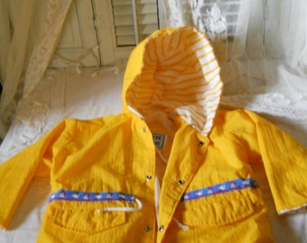 Childs Yellow Windbreaker Jacket with Yellow Striped Attached Hood w/ Drawstring Completely Lined Front Pockets Blue Band w/ Fish  Sailboat