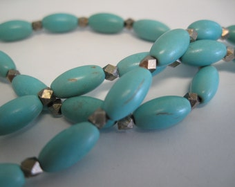 Turquoise colored magnesite necklace with faceted metal spacer beads