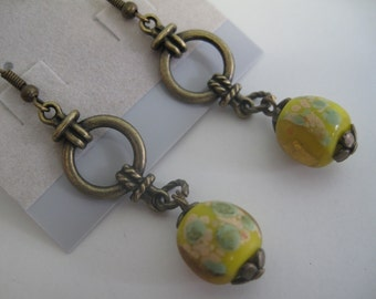 Antique brass and yellow lampwork glass bead earrings