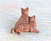 Two Copper Dogs Badge