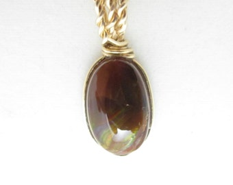 Opal, Boulder, with gold wire wrap 9ct