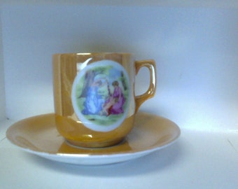 Lustre cup and saucer Made in Japan Victorian scene demitasse or child size