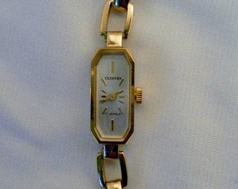 Vintage 1960's Clinton Dress Ladies Bracelet Watch. 17 Jewel Mechanical. White Dial w Gold Markers.  Swiss 59-21 Mvt.  Winds, Runs.