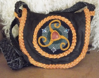 Celtic triskelion symbol with Carnelion stone purse, black deersin with deep golden deerskin lacing
