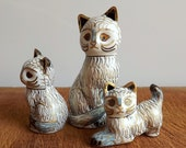 Three vintage cloisonné cats, white and gold