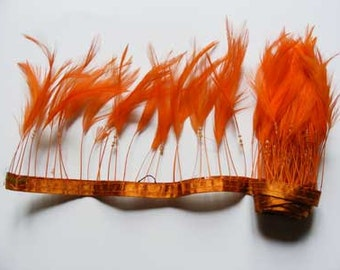 Approx1 metre of Stripped Hackle Feather Fringe on Ribbon - Orange