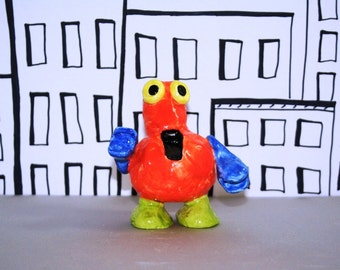 Orange Robot Whistle is part of the gang but ready to travel to you! He's bright, makes a wonderful sound and fun to have around.