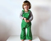 Green kids overalls childrens clothing flared dungarees corduroy pants apple vintage retro style hippie flares rainbow spring colourful