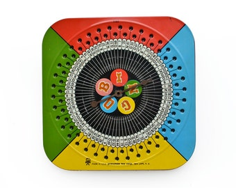 vintage tin, tin bingo spinner, vintage tin toy, primary colors, vintage game, game spinner, from Elizabeth Rosen