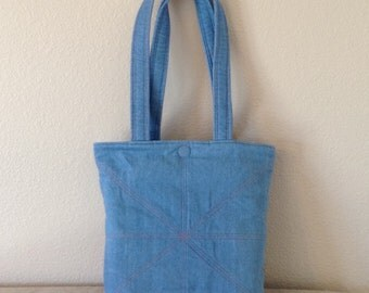 Stonewashed denim quilted heavy weight with magnetic closure tote