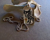 hand painted glass pendant. primitive.heron.