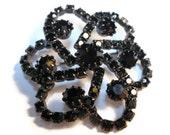 Black rhinestone brooch pin, prong set japanned brooch, bold, and impressive.