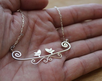 Bird necklace. silver bird. silver bird necklace. bird on a branch. 2 birds. animal necklace. woodlands. nature