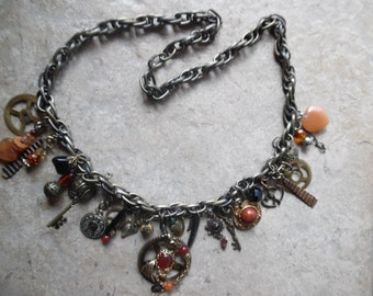 whimsical Steampunk Necklace handcrafted  many charms ,vintage pieces,gears ,stones