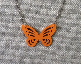 Butterfly pendant made from orange paper